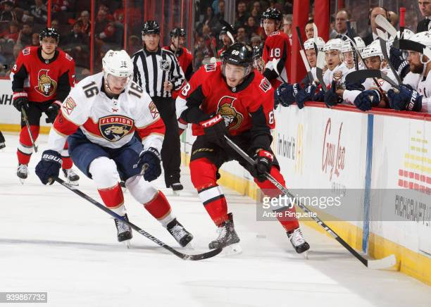Mike Hoffman of the Ottawa Senators stickhandles the puck against Aleksander Barkov of the Florida Panthers at Canadian Tire Centre on March 29 2018...