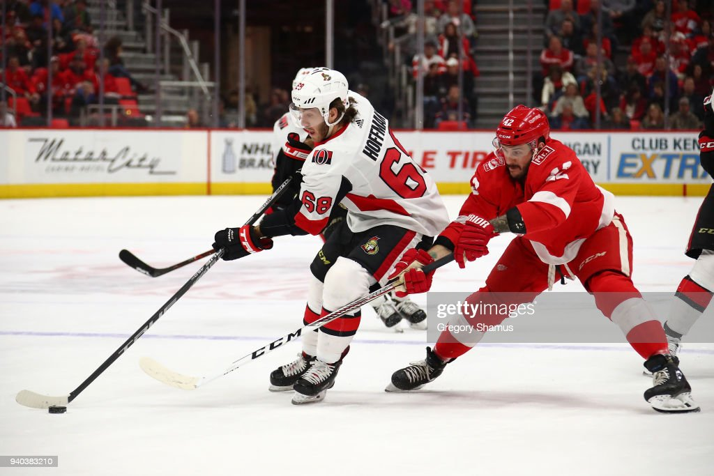 Mike Hoffman #68 of the Ottawa Senators tries to get around the stick of Martin Frk #42 of the Detroit Red Wings during the first period at Little Caesars Arena on March 31, 2018 in Detroit, Michigan.