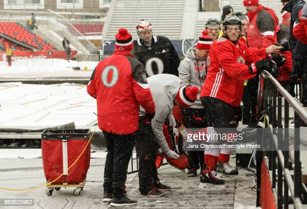 Mike Hoffman of the Ottawa Senators waits to have his skate guard put on by staff after leaving the ice following practice at Lansdowne Park on...