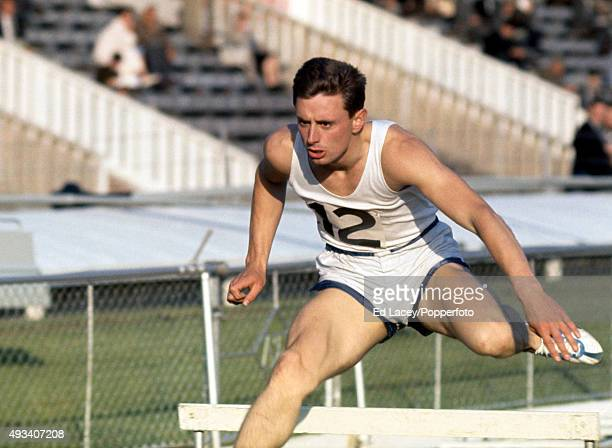 Mike Hogan of Great Britain competing in the men's 440 yards hurdles event during the Amateur Athletics Association Championships at White City in...