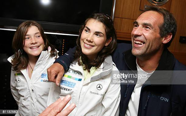 Mike Horn poses with his daughters Jessica and Annika as they visit the Pangaea boat at the Monaco Yacht Club on May 17 2008 in Monte Carlo Monaco...