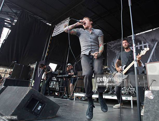 Mike Hranica of The Devil Wears Prada performs during Vans Warped Tour '14 at First Midwest Bank Amphitheatre on July 19 2014 in Tinley Park Illinois