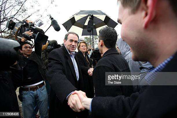 Mike Huckabee and his wife, Janet, visit with voters and supporters in Columbia, South Carolina, Saturday, January 19, 2008.