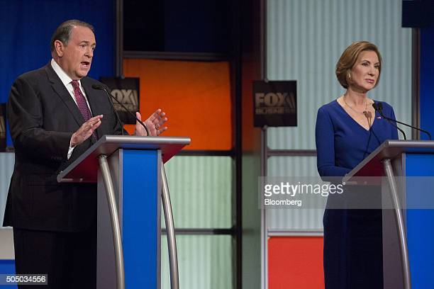 Mike Huckabee former governor of Arkansas and 2016 Republican presidential candidate left speaks as Carly Fiorina former chairman and chief executive...