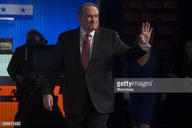 Mike Huckabee former governor of Arkansas and 2016 Republican presidential candidate waves while arriving to the Republican presidential candidate...