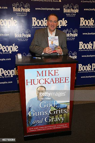 Mike Huckabee signs copies of his new book God Guns Grits and Gravy at Book People on February 5 2015 in Austin Texas