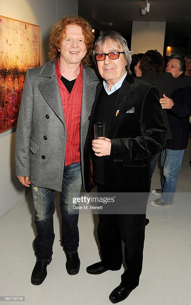 Mike Hucknall (L) and Bill Wyman attend a private view of Bill Wyman's new exhibit 'Reworked' at Rook & Raven Gallery on February 26, 2013 in London, England.