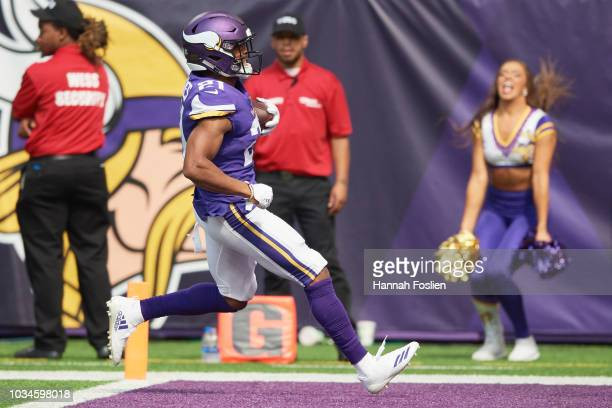 Mike Hughes of the Minnesota Vikings carries the ball after an interception for a touchdown against the San Francisco 49ers during the game on...