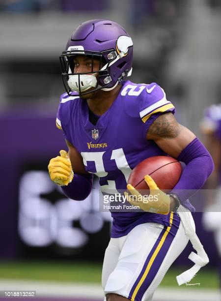 Mike Hughes of the Minnesota Vikings carries the ball as he warms up before the preseason game against the Jacksonville Jaguars on August 18 2018 at...
