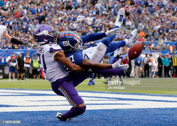 Mike Hughes of the Minnesota Vikings defends against Sterling Shepard of the New York Giants at MetLife Stadium on October 06 2019 in East Rutherford...