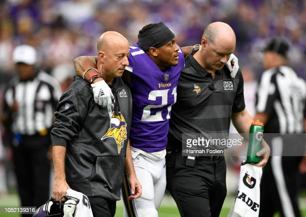 Mike Hughes of the Minnesota Vikings is helped off the field after sustaining an injury in the fourth quarter of the game against the Arizona...