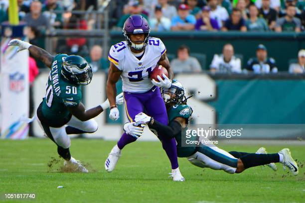 Mike Hughes of the Minnesota Vikings is tackled by Avonte Maddox of the Philadelphia Eagles as LaRoy Reynolds looks on during the first quarter at...