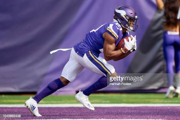 Mike Hughes of the Minnesota Vikings returns a kick during the game against the Buffalo Bills at US Bank Stadium on September 23 2018 in Minneapolis...