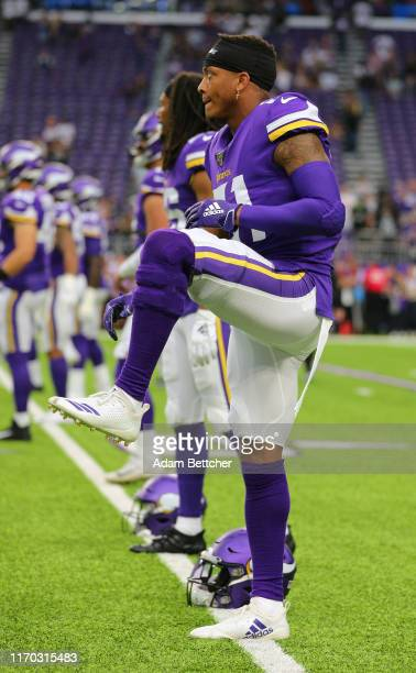Mike Hughes of the Minnesota Vikings stretches during the pre game warm up against the Oakland Raiders at US Bank Stadium on September 22 2019 in...