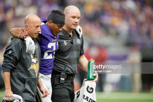 Mike Hughes of the Minnesota Vikings walks off the field with trainers after an injury during the game against the Arizona Cardinals at US Bank...