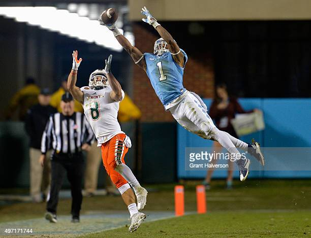 Mike Hughes of the North Carolina Tar Heels breaks up a pass intended for Braxton Berrios of the Miami Hurricanes during their game at Kenan Stadium...