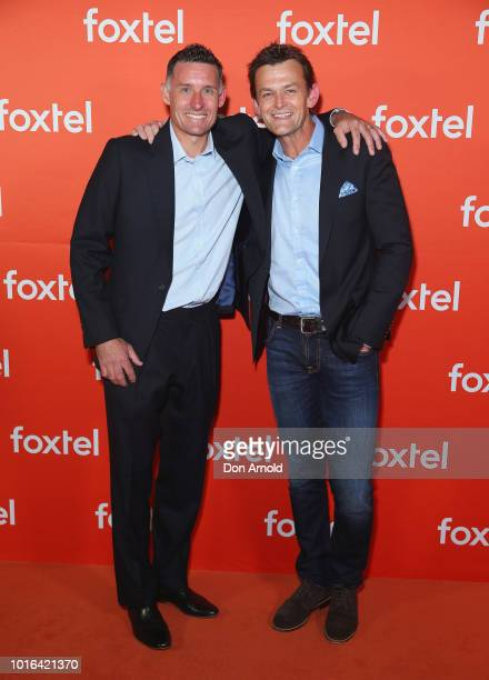 Mike Hussey and Adam Gilchrist arrive ahead of the Foxtel Launch Event at Fox Studios on August 14 2018 in Sydney Australia