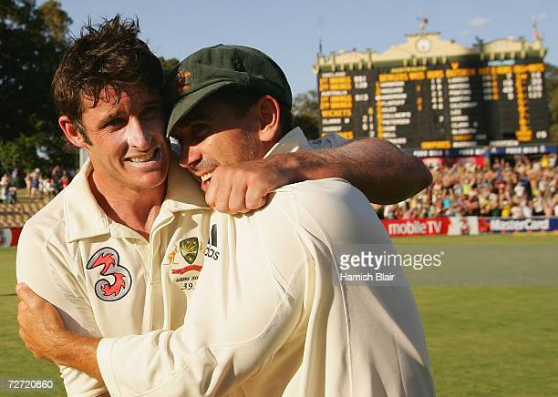 Mike Hussey and Justin Langer of Australia celebrate victory on day five of the second Ashes Test Match between Australia and England at the Adelaide...