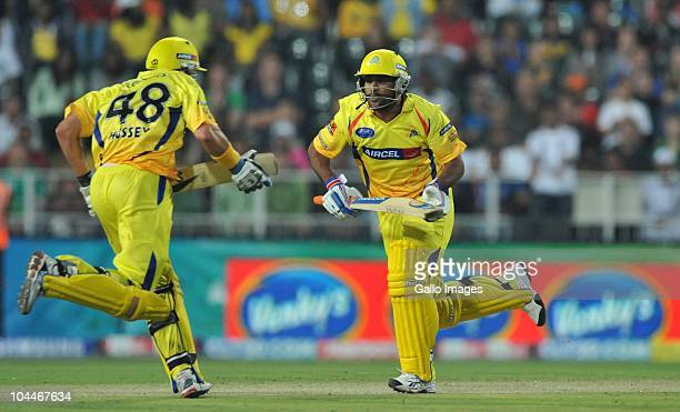 Mike Hussey and Mahendra Singh Dhoni of the Kings on the run during the 2010 Airtel Champions League Twenty20 final match between Chennai Super Kings...