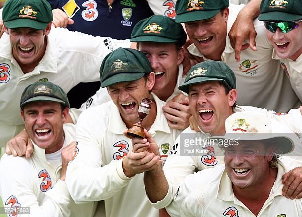 Mike Hussey, Matthew Hayden, Adam Gilchrist, Brett Lee, Stuart Clark Ricky Ponting, Shane Warne and Michael Clarke of Australia pose with a replica...