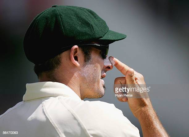 Mike Hussey of Australia applies zinc cream during day five of the First Test between Australia and South Africa played at the WACA December 20 2005...