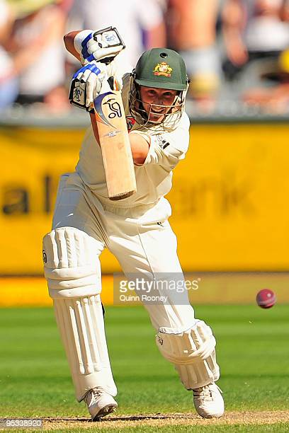 Mike Hussey of Australia plays an off drive during day one of the First Test match between Australia and Pakistan at Melbourne Cricket Ground on...