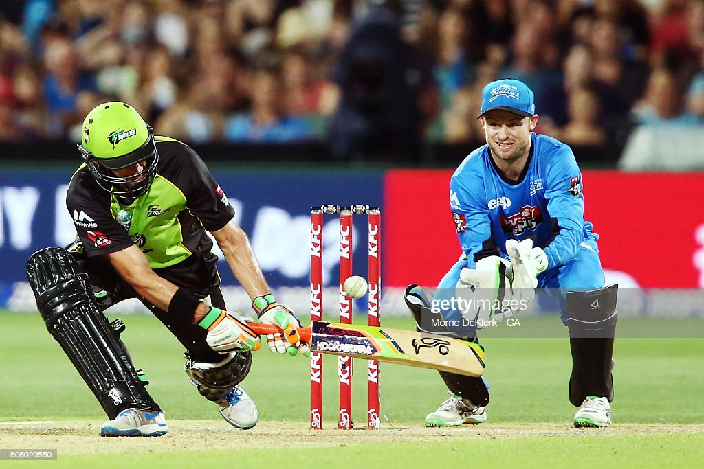 Mike Hussey of the Sydney Thunder plays a shot to get out as Tim Ludeman of the Adelaide Strikers looks on during the Big Bash League Semi Final match between the Adelaide Strikers and the Sydney Thunder at Adelaide Oval on January 21, 2016 in Adelaide, Australia.