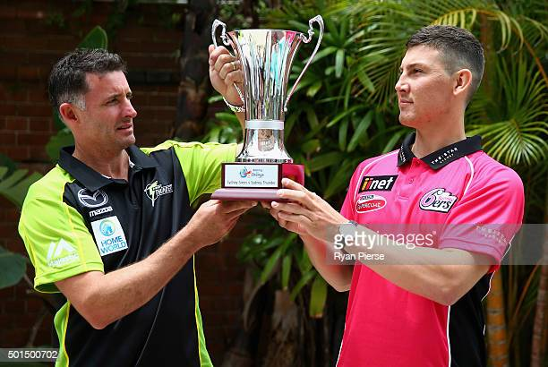 Mike Hussey of the Thunder and Nic Maddinson of hte Sixers pose with the Batting for Change Cip during a Big Bash League media opportunity on...