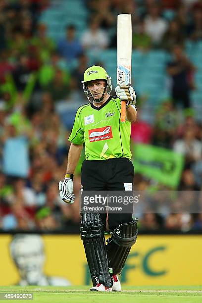 Mike Hussey of the Thunder celebrates after scoring a half century during the Big Bash League match between Sydney Thunder and the Adelaide Strikers...