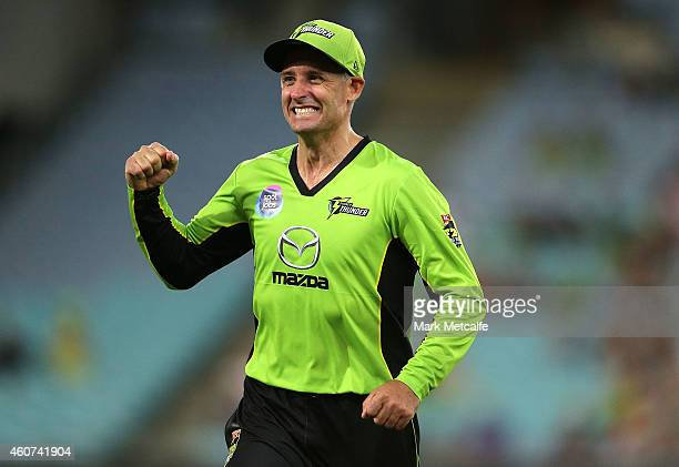 Mike Hussey of the Thunder celebrates the wicket of Andrew Flintoff of the Heat during the Big Bash League match between the Sydney Thunder and...