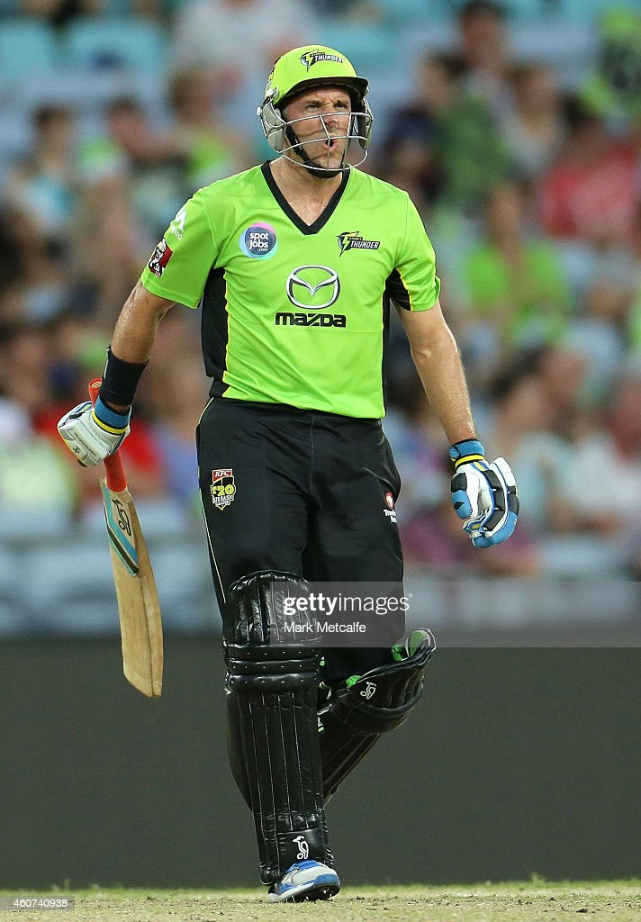 Mike Hussey of the Thunder reacts to hitting a six during the Big Bash League match between the Sydney Thunder and Brisbane Heat at ANZ Stadium on December 21, 2014 in Sydney, Australia.