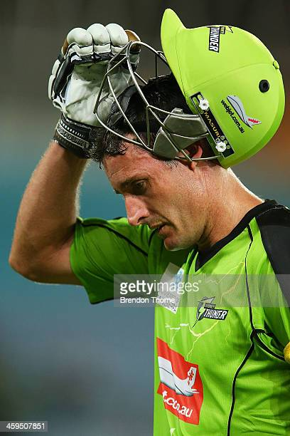 Mike Hussey of the Thunder walks off the field after being dismissed by Shaun Tait of the Strikers during the Big Bash League match between Sydney...
