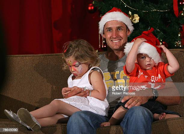 Mike Hussey with children Jasmin and Will pose during the Australian cricket team Christmas lunch at Crown Casino on December 25 2007 in Melbourne...