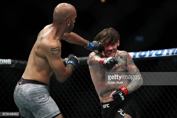 Mike Jackson lands a punch against CM Punk in the first round in their welterweight bout during the UFC 225 Whittaker v Romero 2 event at the United...