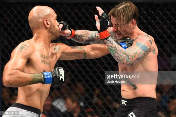 Mike Jackson punches CM Punk in their welterweight fight during the UFC 225 event at the United Center on June 9 2018 in Chicago Illinois