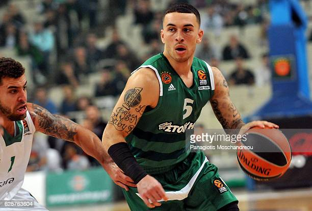 Mike James #5 of Panathinaikos Superfoods Athens competes with Scottie Wilbekin #1 of Darussafaka Dogus Istanbul during the 2016/2017 Turkish...