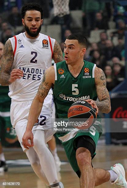Mike James #5 of Panathinaikos Superfoods Athens competes with Tyler Honeycutt #2 of Anadolu Efes Istanbul during the 2016/2017 Turkish Airlines...
