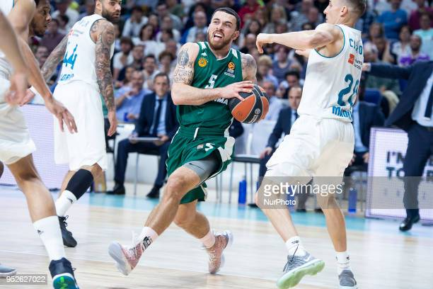 Mike James of Panathinaikos Superfoods vies Jaycee Carroll #20 of Real Madrid during the Turkish Airlines Euroleague Play Offs Game 4 between Real...