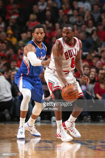 Mike James of the Chicago Bulls handles the ball against the Los Angeles Clippers on January 24 2014 at the United Center in Chicago Illinois NOTE TO...