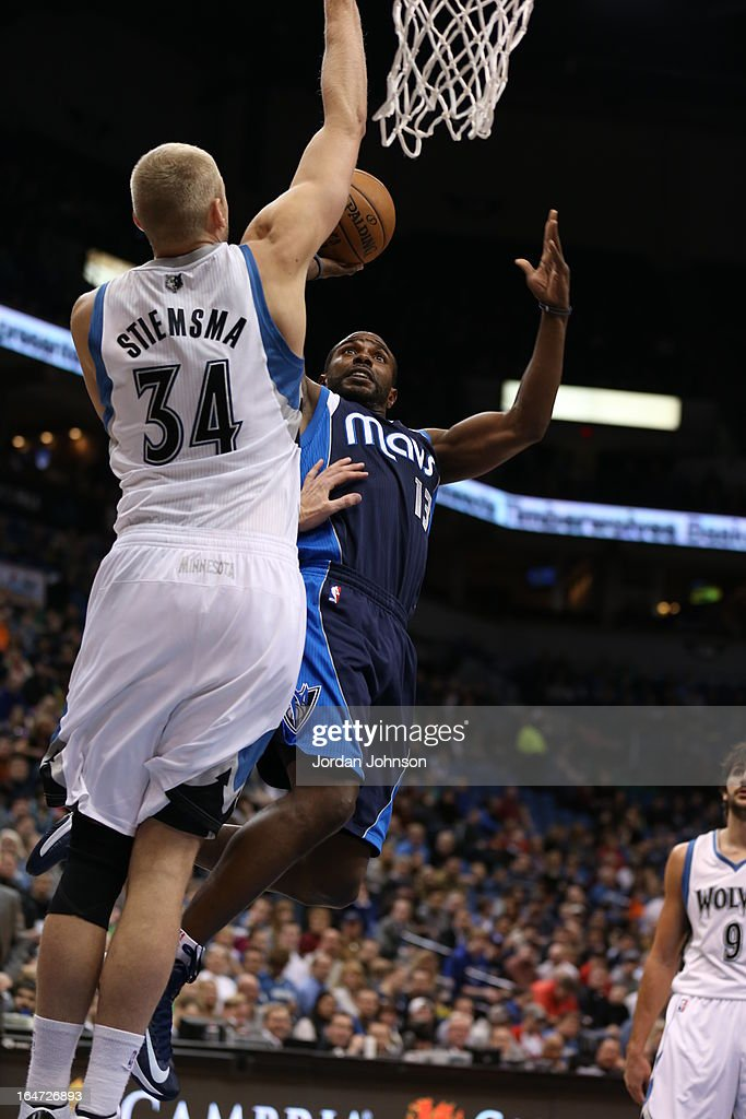 Mike James #13 of the Dallas Mavericks drives to the basket against the Minnesota Timberwolves on March 10, 2013 at Target Center in Minneapolis, Minnesota.