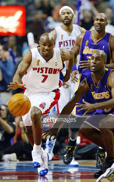 Mike James of the Detroit Pistons dribbles past Gary Payton of the Los Angeles Lakers during the second quarter in game four of the 2004 NBA Finals...