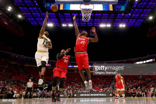 Mike James of the Killer 3's attempts a shot while being guarded by Rashad McCants and Dion Glover of Trilogy during BIG3 Week Four at Little Caesars...
