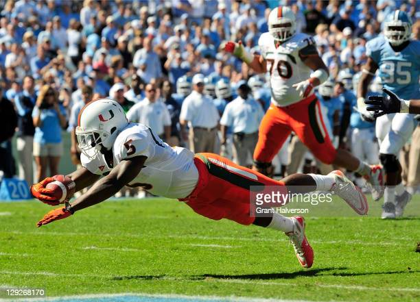 Mike James of the Miami Hurricanes dives into the end zone for a touchdown against the North Carolina Tar Heels at Kenan Stadium on October 15 2011...