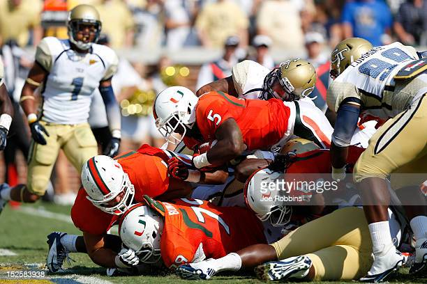 Mike James of the Miami Hurricanes dives over the goal line for a oneyard touchdown against the Georgia Tech Yellow Jackets during first half action...