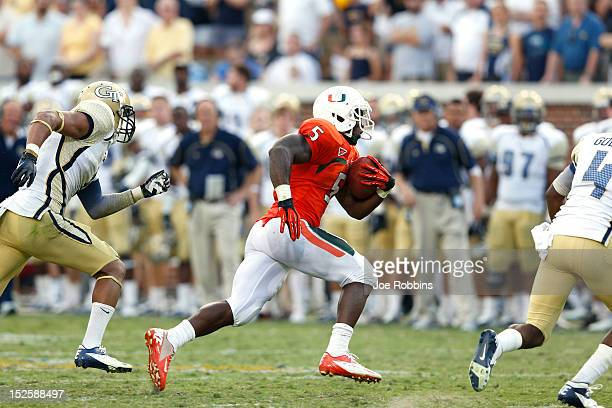 Mike James of the Miami Hurricanes runs for a 25yard touchdown in overtime to win the game against the Georgia Tech Yellow Jackets at Bobby Dodd...
