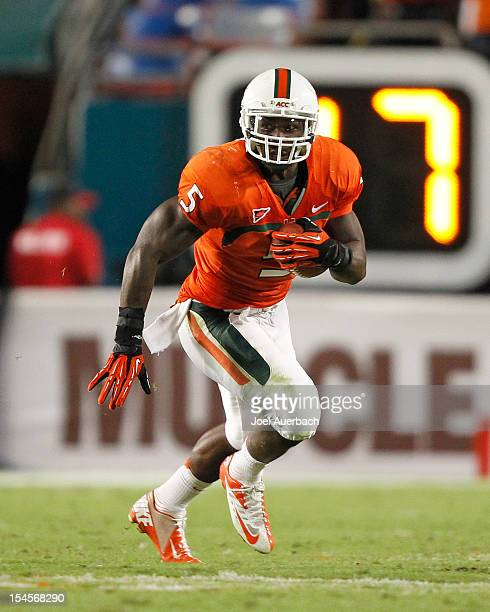 Mike James of the Miami Hurricanes runs with the ball against the Florida State Seminoles on October 20 2012 at Sun Life Stadium in Miami Gardens...