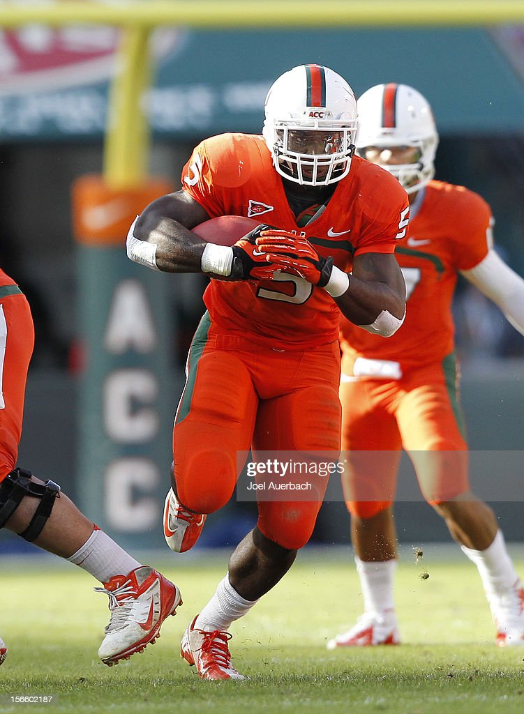 Mike James #5 of the Miami Hurricanes runs with the ball against the South Florida Bulls on November 17, 2012 at Sun Life Stadium in Miami Gardens, Florida. The Hurricanes defeated the Bulls 40-9.