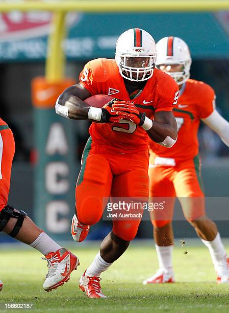 Mike James of the Miami Hurricanes runs with the ball against the South Florida Bulls on November 17 2012 at Sun Life Stadium in Miami Gardens...