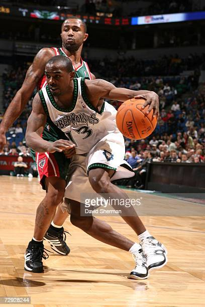 Mike James of the Minnesota Timberwolves drives around Maurice Williams of the Milwaukee Bucks on December 22 2006 at the Target Center in...