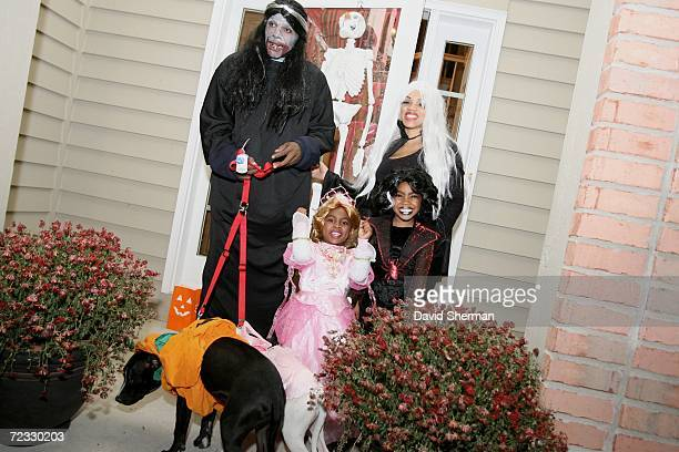 Mike James of the Minnesota Timberwolves poses for a picture with his wife Angela, daughters six-year-old Jadon and three-year-old Amaya and dogs...